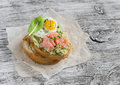 Mashed avocado sandwich with smoked salmon and fried quail egg. A delicious breakfast or snack. Royalty Free Stock Photo
