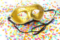 Mask with confetti golden carnival ribbons on a background Stock Photography