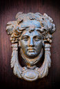 Mask door knocker elegant on wood Stock Photography