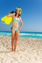 Mask fins and snorkel fun beautiful fit attractive woman on the white sand beach Royalty Free Stock Image