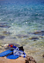 Mask and flippers on a rock beach Royalty Free Stock Photos