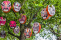 Mask lanterns in the shape of chinese opera masks are hung in a tree during the lantern festival in auckland Stock Photography