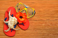 Mask seashell flower and flip flop sandals on the wood wooden board Royalty Free Stock Image