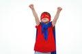 Masked boy pretending to be superhero raising fists on white screen Stock Image