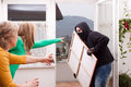 Masked burglar is observed a thief Stock Images