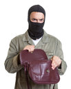 Masked burglar with stolen handbag on an isolated white background for cut out Stock Photography