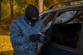 Masked car criminal Royalty Free Stock Photos