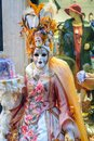 stock image of  Masked Woman in colorful carnival dress