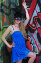 A masked woman tries to blend into the graffiti Royalty Free Stock Photo