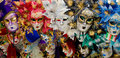 Masks row of venetian in variety of colors Royalty Free Stock Photography