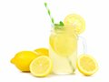 Mason jar of lemonade with lemons and straw over white Royalty Free Stock Photo