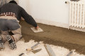 Mason smooth the cement screed with trowel Stock Image
