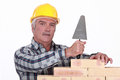 Mason with a trowel Royalty Free Stock Photo