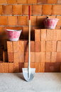 Masonry bricks shovel and buckets in a under construction site Stock Photos