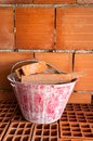 Masonry bucket on hollow bricks red with in a work site Stock Photography
