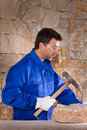 Masonry mason stonecutter man with hammer working Royalty Free Stock Photo