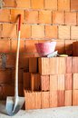 Masonry shovel bucket and bricks brick wall with many Stock Photo