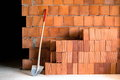 Masonry shovel bucket and bricks brick wall with many in a under construction site Stock Photo