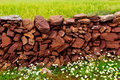 Masonry stonewall in spring with flowers menorca at balearic islands Stock Image