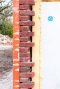Masonry wall with cavity wall insulation