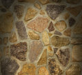 Masonry wall with irregular stones lit from above Royalty Free Stock Photography