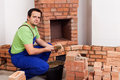 Masonry worker building fireplace Stock Photo
