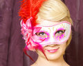 Masquerade an attractive woman poses with her venetian mask Stock Photo