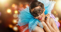 Masquerade mask cute girl in Stock Photography
