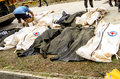 Mass grave for victims of typhoon haiyan in philippines tacloban city november a total cadavers black bags were laid a nearby a Stock Photos