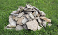 A mass of rocks on the green grass photo Stock Photography