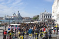 Mass tourism in venice italy lots of people near st mark s square with st maria salute basilica the back Royalty Free Stock Images