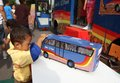 Mass transportation campaign children looking at bus miniature at in solo central java indonesia Royalty Free Stock Images