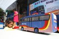Mass transportation campaign children looking at bus miniature at in solo central java indonesia Stock Photography
