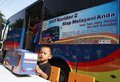 Mass transportation campaign children looking at bus miniature at in solo central java indonesia Stock Photo