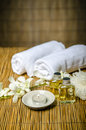 Massage concept oil and white towels Royalty Free Stock Images
