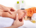 Massage of human foot in salon Royalty Free Stock Images