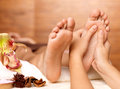 Massage of human foot in spa salon soft focus image Stock Images