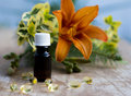 Massage oil with vitamin pills for complete relaxation Royalty Free Stock Images