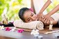 Massage of shoulder masseur doing on female in the beauty salon Stock Image