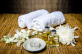 Massage and spa concept product oil towels Royalty Free Stock Photo