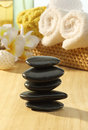 Massage stones stacked in spa setting Royalty Free Stock Photo