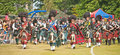 Massed pipe bands at forres games highland held on th july marching into the arena and taking part in the competition for best Stock Photo