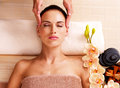 Masseur doing massage the head of an woman in spa salon adult Royalty Free Stock Photography