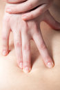 Masseur's hands doing deep tissue massage