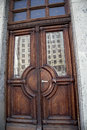 Massive oak doors old with a reflection Royalty Free Stock Photography