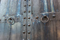 Massive old black weathered steel door with skeleton key lock Royalty Free Stock Photo