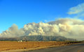 Massive plumes of brush fire smoke wild in point mugu state park mountains near camarillo ca Royalty Free Stock Images