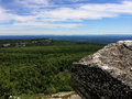 Massive rocks and view to the valley at minnewaska state park reserve upstate ny during summer time Royalty Free Stock Photo