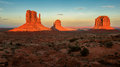 Massive sandstone pillars soar above iconic Monument Valley at sunset Royalty Free Stock Photo