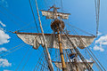 Mast with sails of an old sailing vessel Stock Image